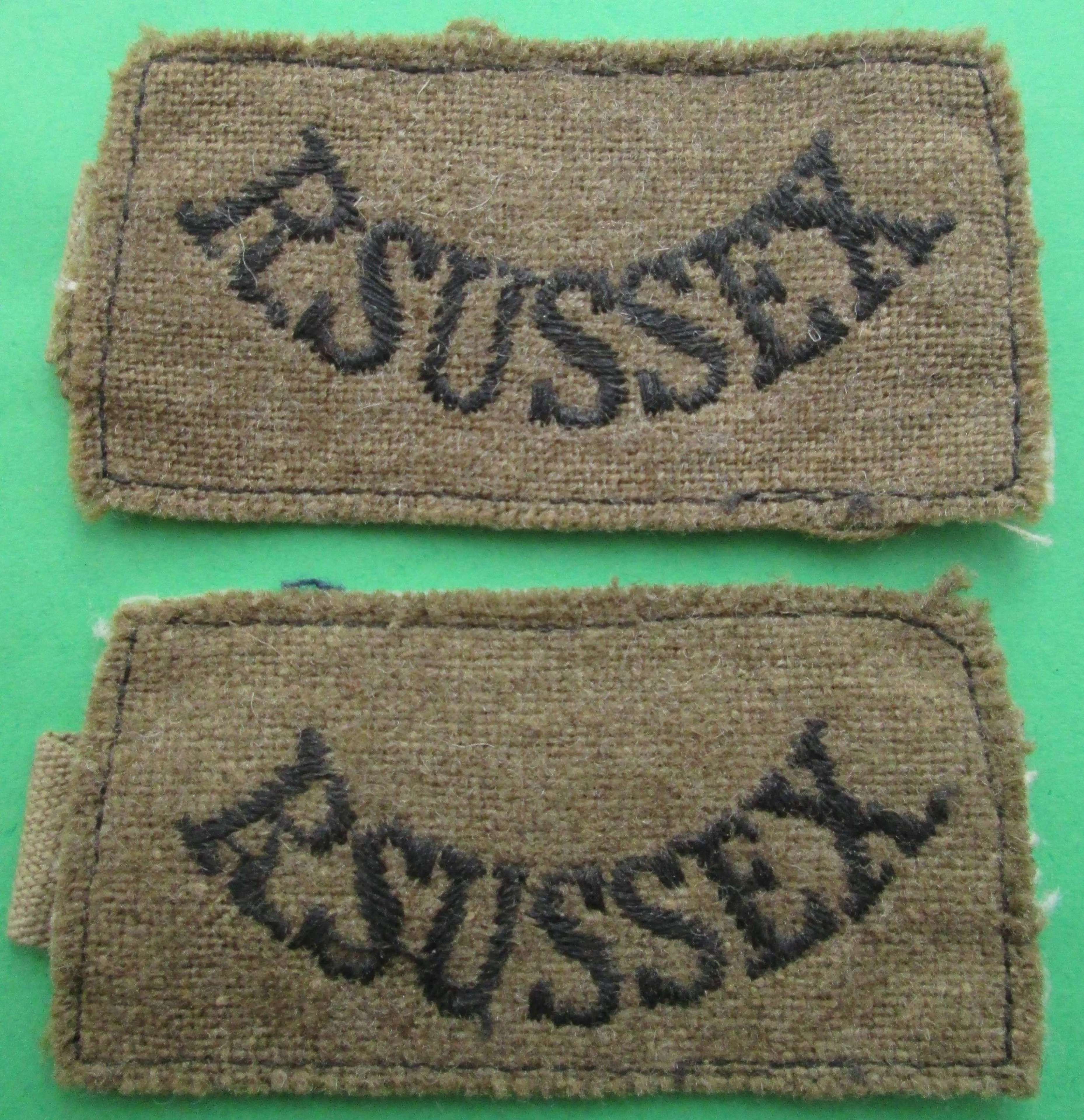 A PAIR OF WWII PERIOD ROYAL SUSSEX SLIP ON SHOULDER TITLES