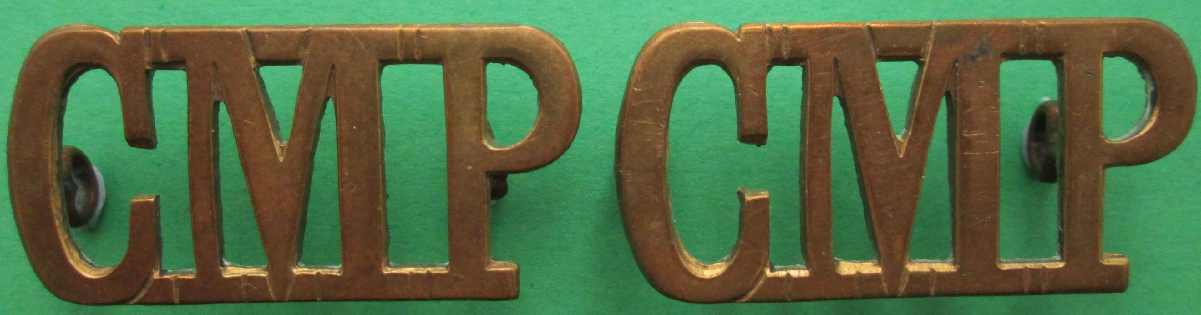 A PAIR OF LARGE CMP ( CORPS OF MILITARY POLICE ) METAL SHOULDER TITLES