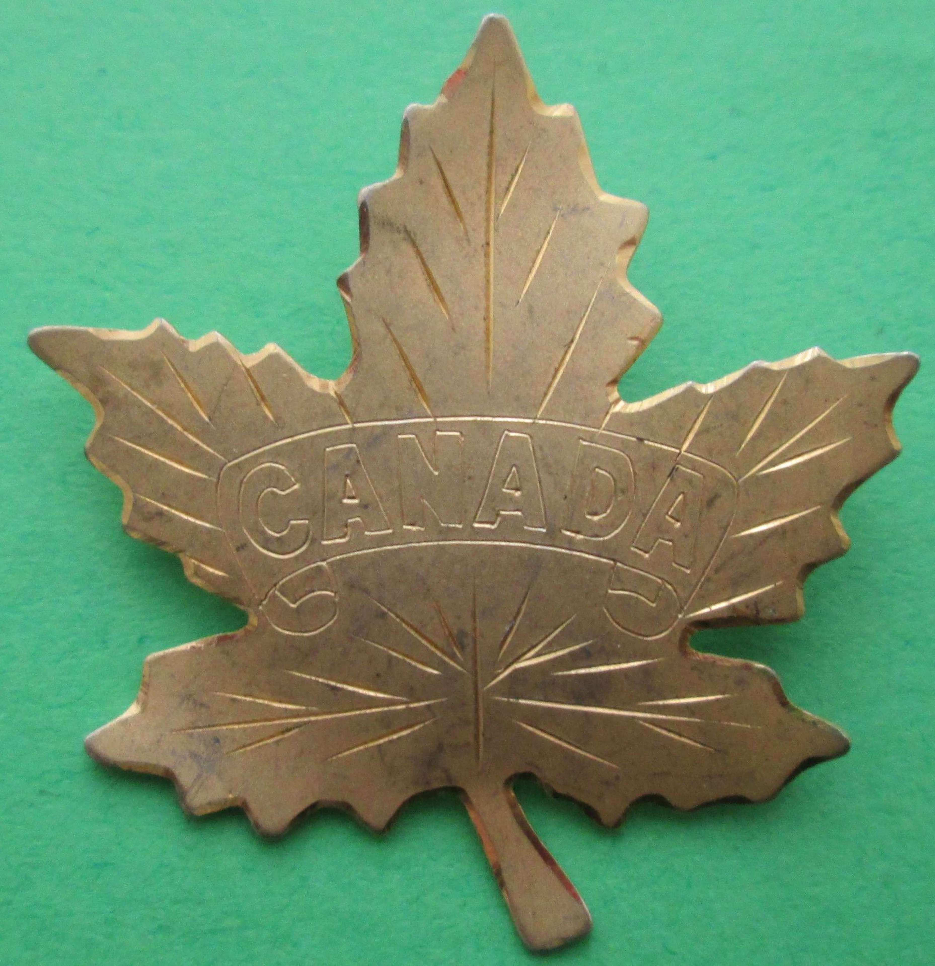 A GOLD PLATED CANADIAN SWEETHEART BROOCH