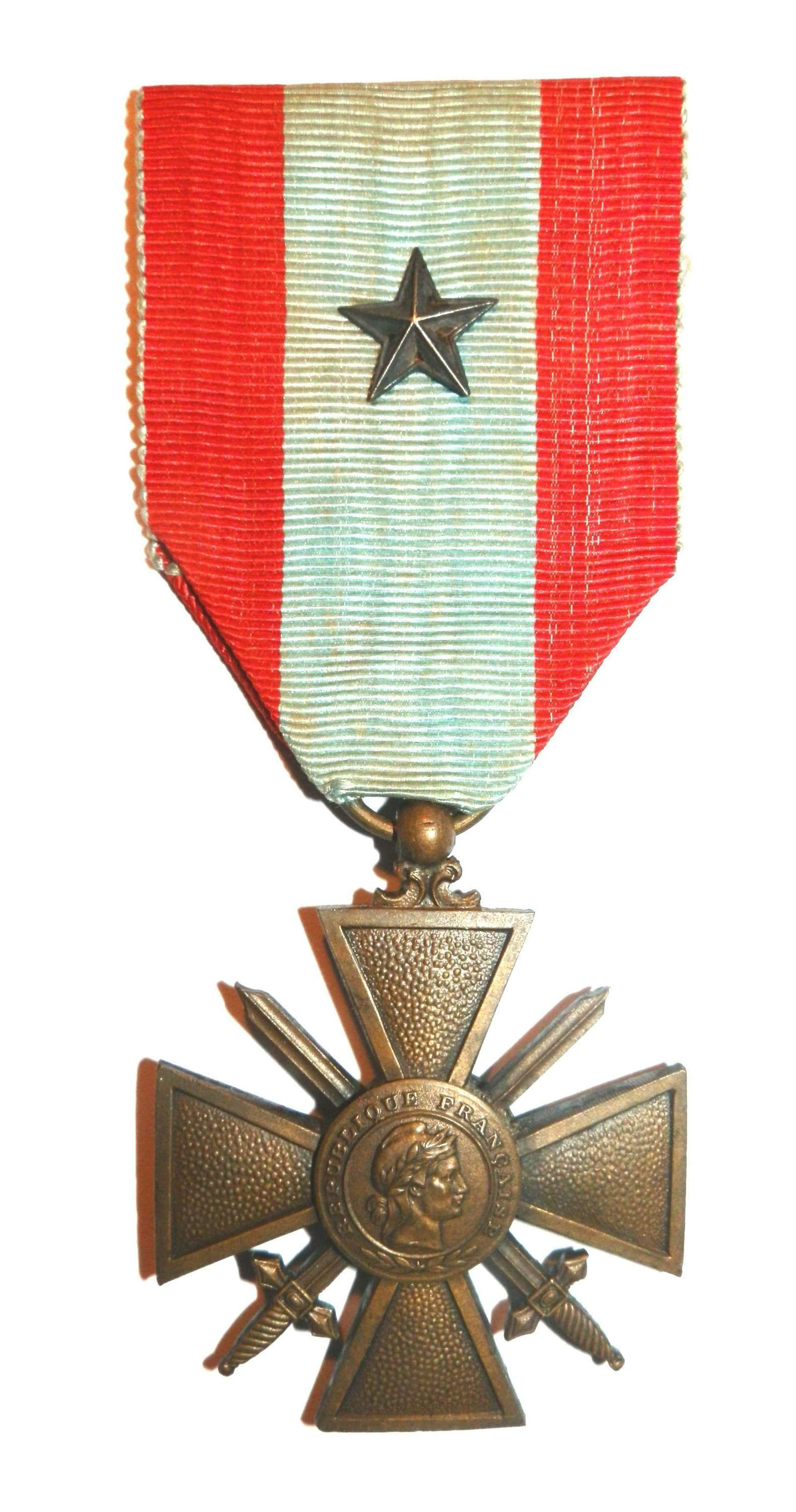 The War Cross T.O.E. Croix de Guerre, Theatre of Operations Award.