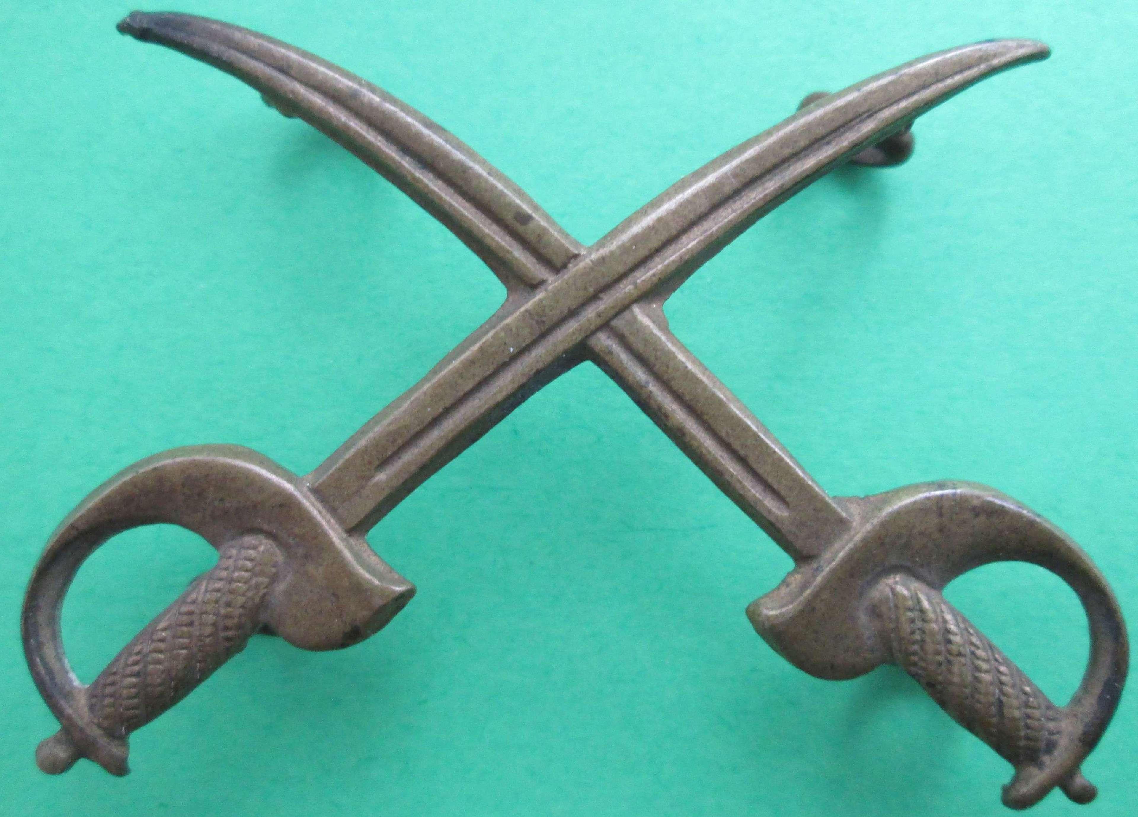 A PTI METAL ARM BADGE