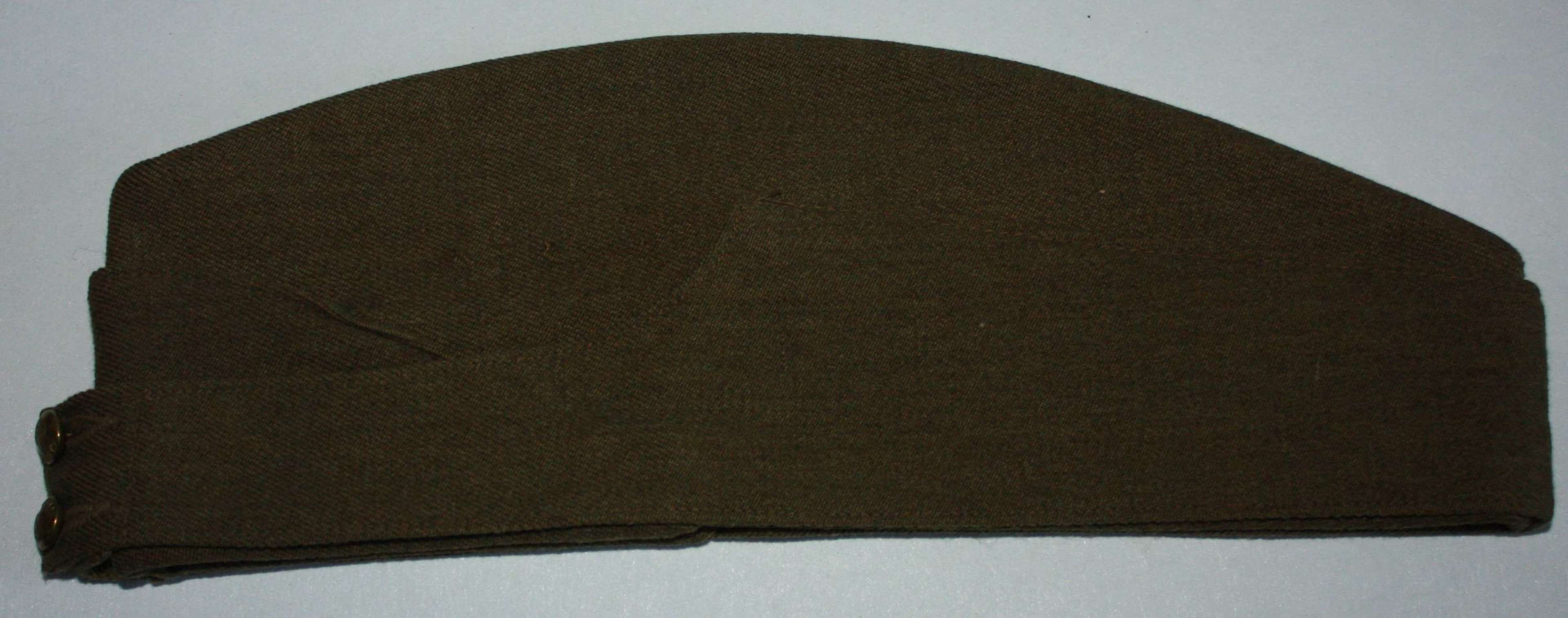 A GOOD WWII CANADIAN 1943 DATED OTHER RANKS SIDE CAP