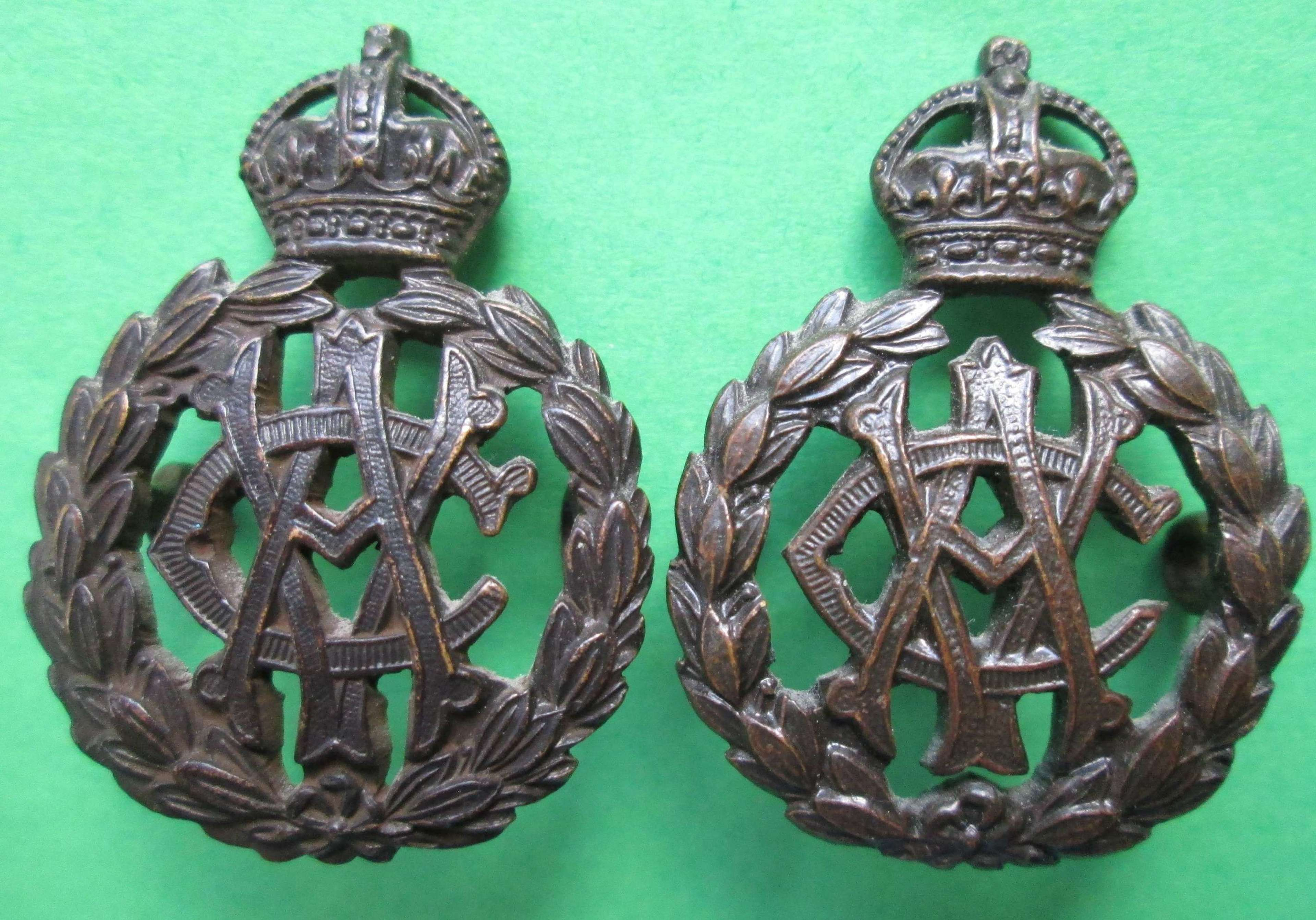 A PAIR OF OFFICER'S BRONZE ARMY VETERINARY CORPS COLLAR DOGS